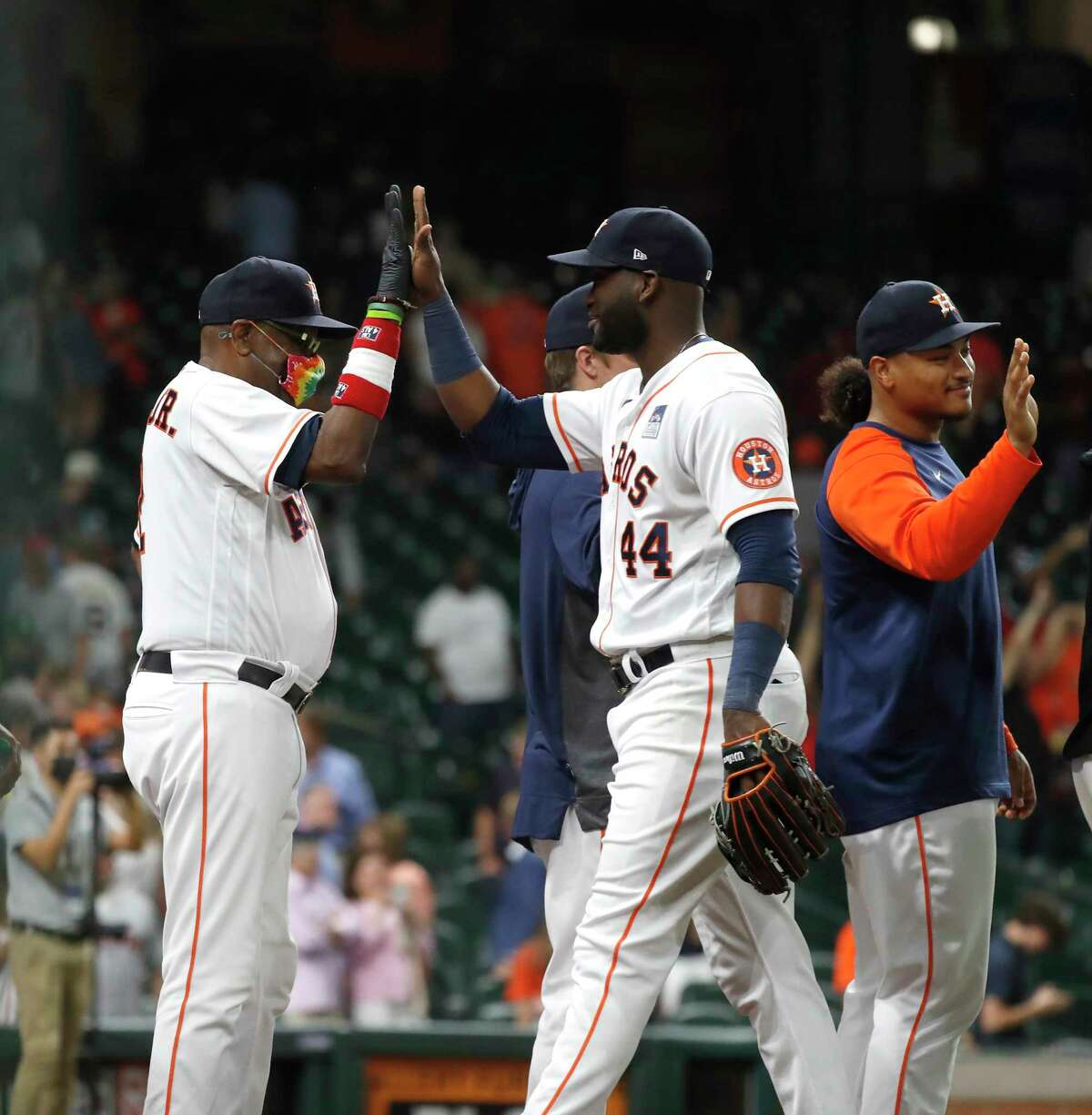 Houston Astros Yordan Alvarez (44) and manager Dusty Baker Jr. (12) celebrate the Astros 2-1 win over the Boston Red Sox during the ninth inning of an MLB baseball game at Minute Maid Park, Wednesday, June 2, 2021, in Houston.