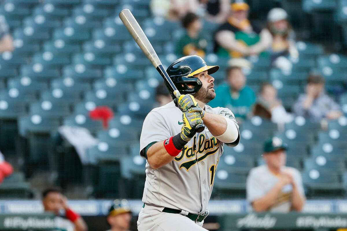 SEATTLE, WASHINGTON - JUNE 02: Mitch Moreland #18 of the Oakland Athletics watches his two run home run in the third inning during Lou Gehrig Day at T-Mobile Park on June 02, 2021 in Seattle, Washington. (Photo by Steph Chambers/Getty Images)