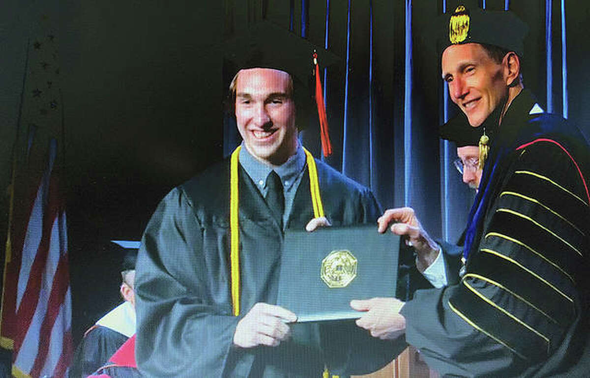 Luke Overton of Jacksonville receives his degree from Anderson University in Anderson, Indiana.