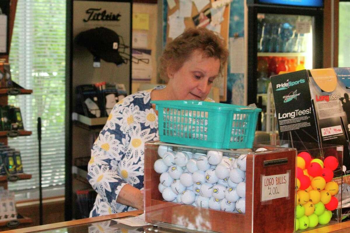 Kathy Vandonkelaar takes care of paperwork at Marquette Trails on Monday. (Star photo/John Raffel)