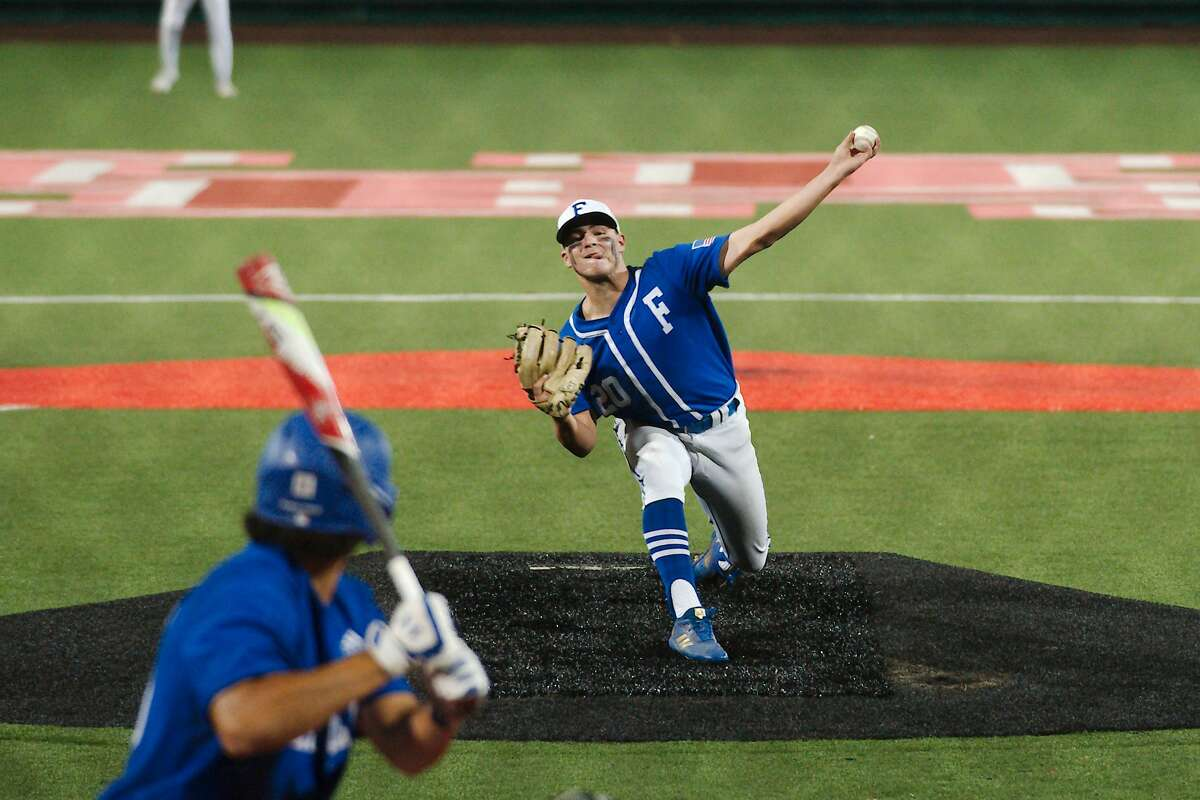 Friendswood'sJaxson Burch (20) pitches against Barbers Hill'sSimon Larranaga (25) Wednesday, June 2 at the University of Houston.