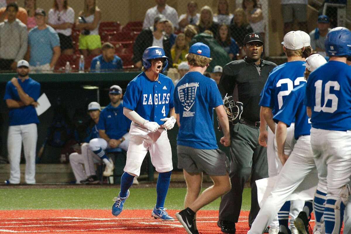 Barbers Hill'sCameron Cauley (4) celebrates after hitting a home runagainst Friendswood.
