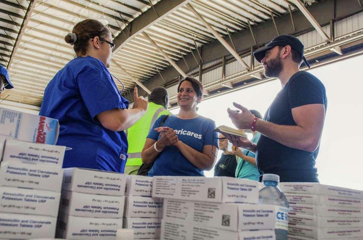 Americares relief workers assist Hurricane Dorian evacuees arriving in Nassau on Sept. 7, 2019.