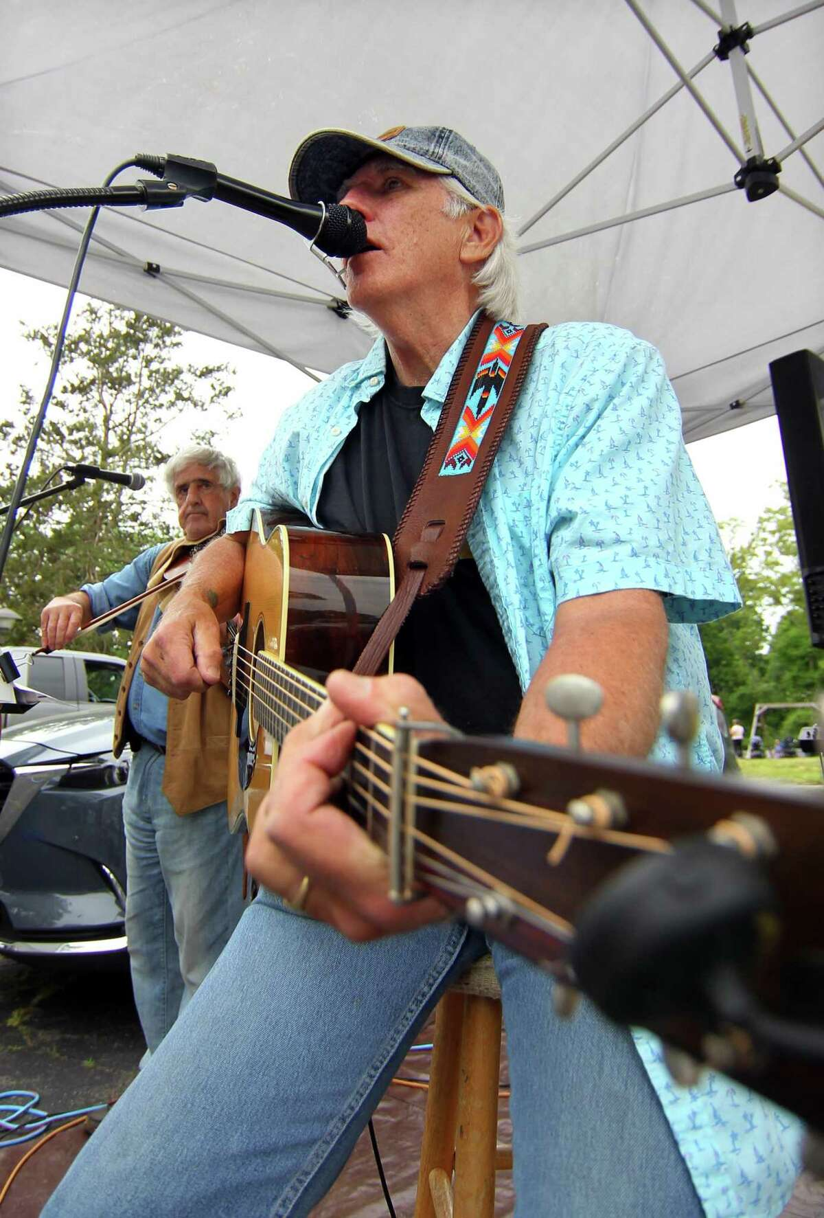 Rick Crossman, who leads the trio Long Meadow, performs during Opening Day of the Old Greenwich Farmer's Market at Living Hope Community Church in Greenwich, Conn., on Wednesday June 2, 2021. The Market is held rain or shine from 2:30 to 6 p.m. at Living Hope Community Church, 38 West End Avenue, Old Greenwich. Residents may also drop off their food scraps during market hours for Greenwich Composts.