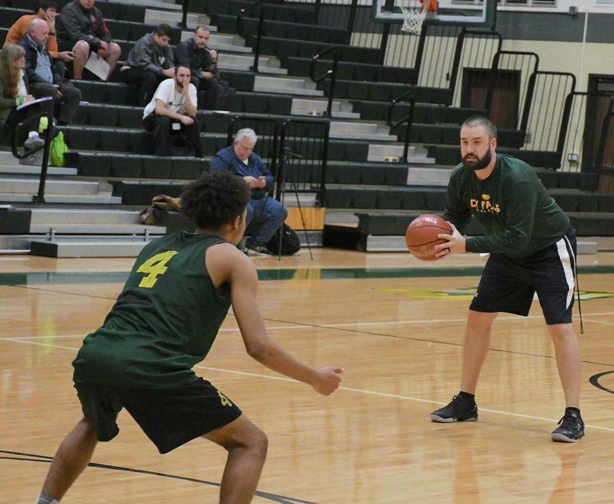 Langham Creek High School is expected to name Cypress Falls High School assistant coach Matt Symmank its new head boys basketball coach.