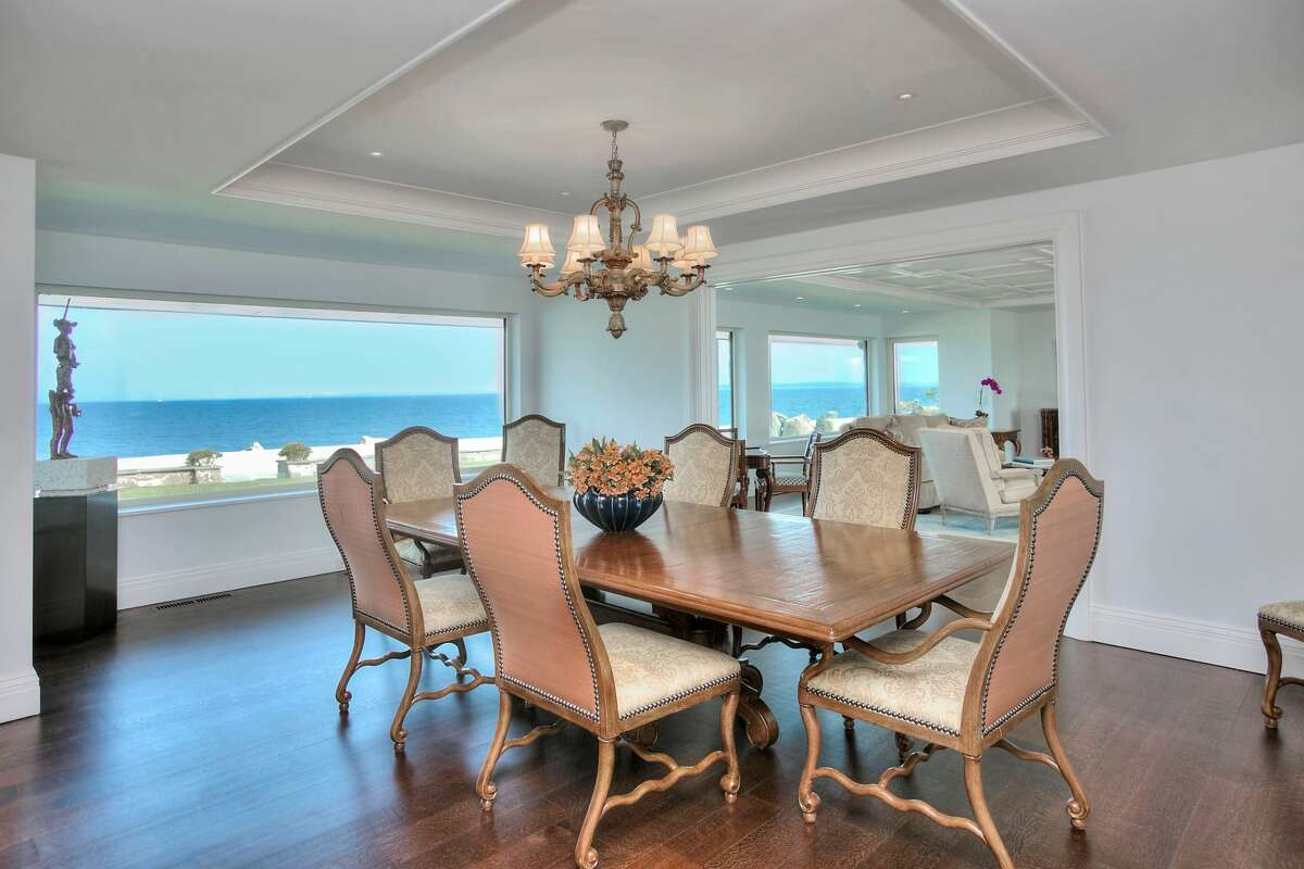 The dining room in the home on 123 Saddle Rock Road in Stamford, Conn. has glass walls that show a view of Long Island Sound.