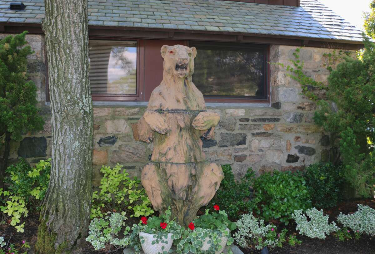 Guarding the 123 Saddle Rock Road home's gated entry is a bear statue, one that vice president of public relations and communications for Sotheby's International Realty Andrew Wood said spurred locals to nickname the property the