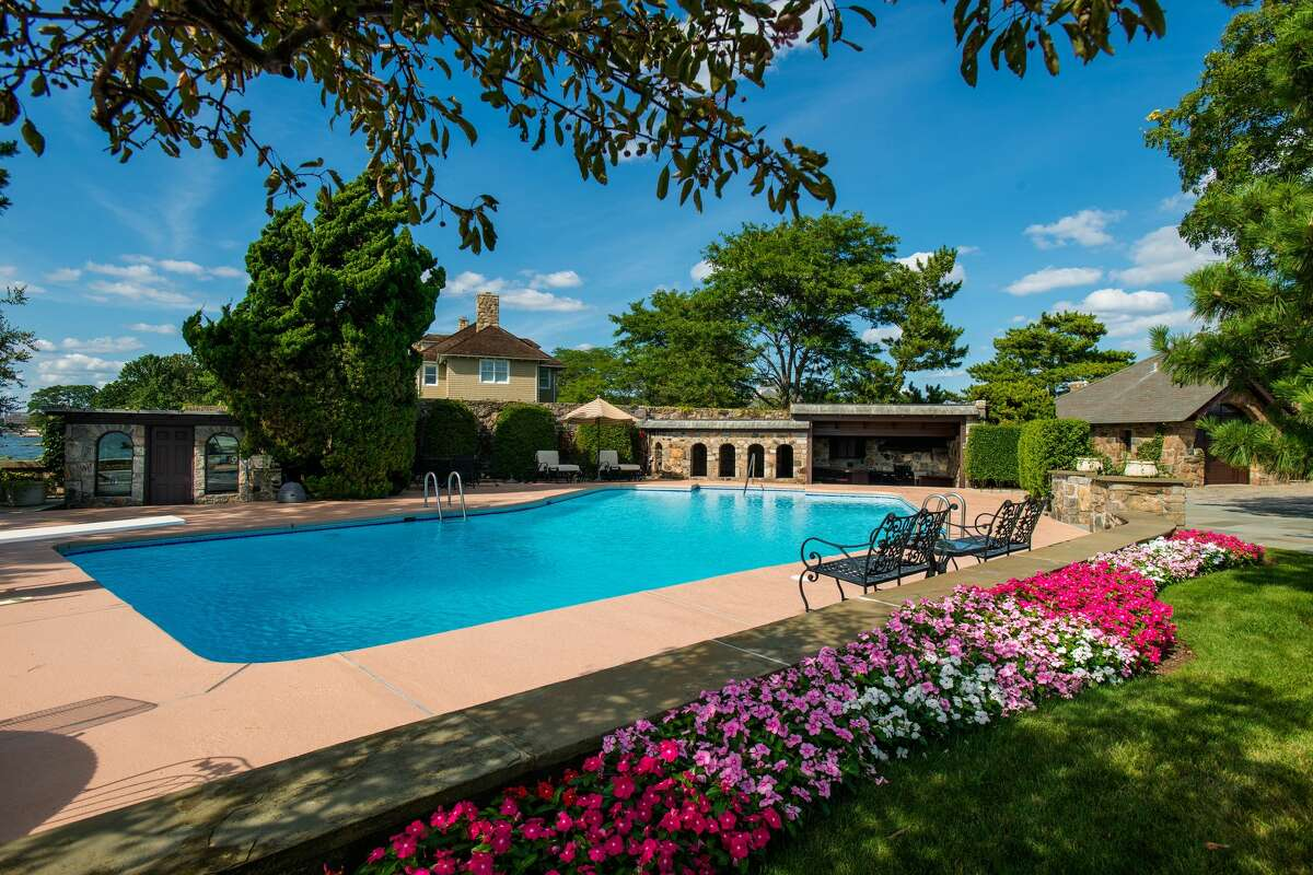 The 1.67 acre property on which 123 Saddle Rock Road house sits has a heated saltwater pool.