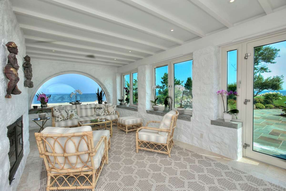 The sun room in the 123 Saddle Rock Road home in Stamford, Conn. is surrounded by glass to reveal a view of Long Island Sound.