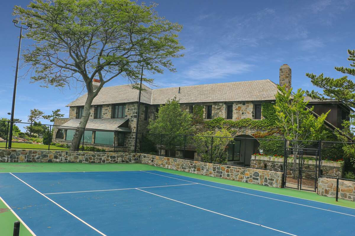 The property on which the 123 Saddle Rock Road home in Stamford, Conn. sits has a lighted full tennis court.