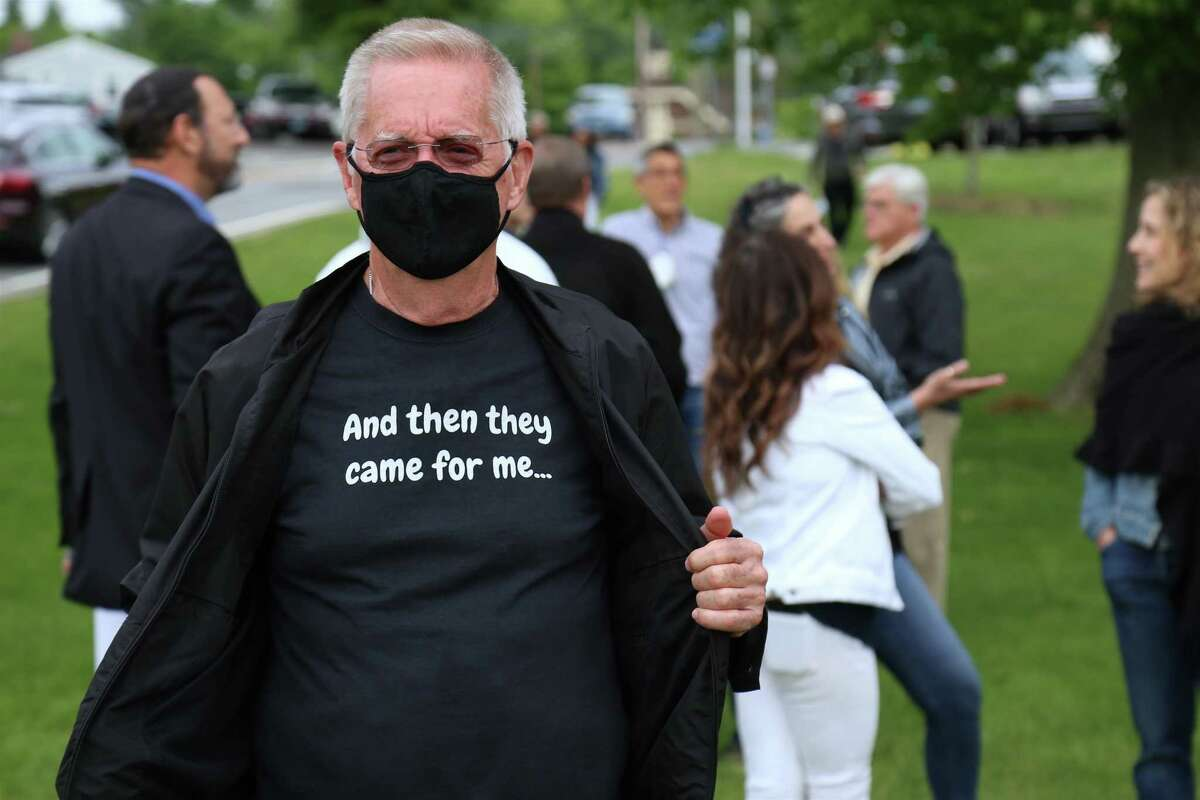 """Chris Burdett of Norwalk sends a message at the """"Standing Together Against Anti-Semitism"""" rally on Jesup Green in Westport on Wednesday, June 2, 2021."""