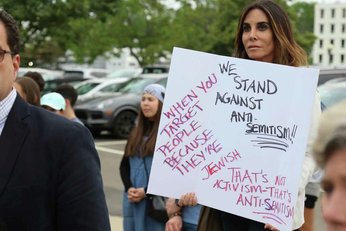 """Hyleri Katzenberg of Westport shares a message at the """"Standing Together Against Anti-Semitism"""" rally on Jesup Green in Westport on Wednesday, June 2, 2021."""