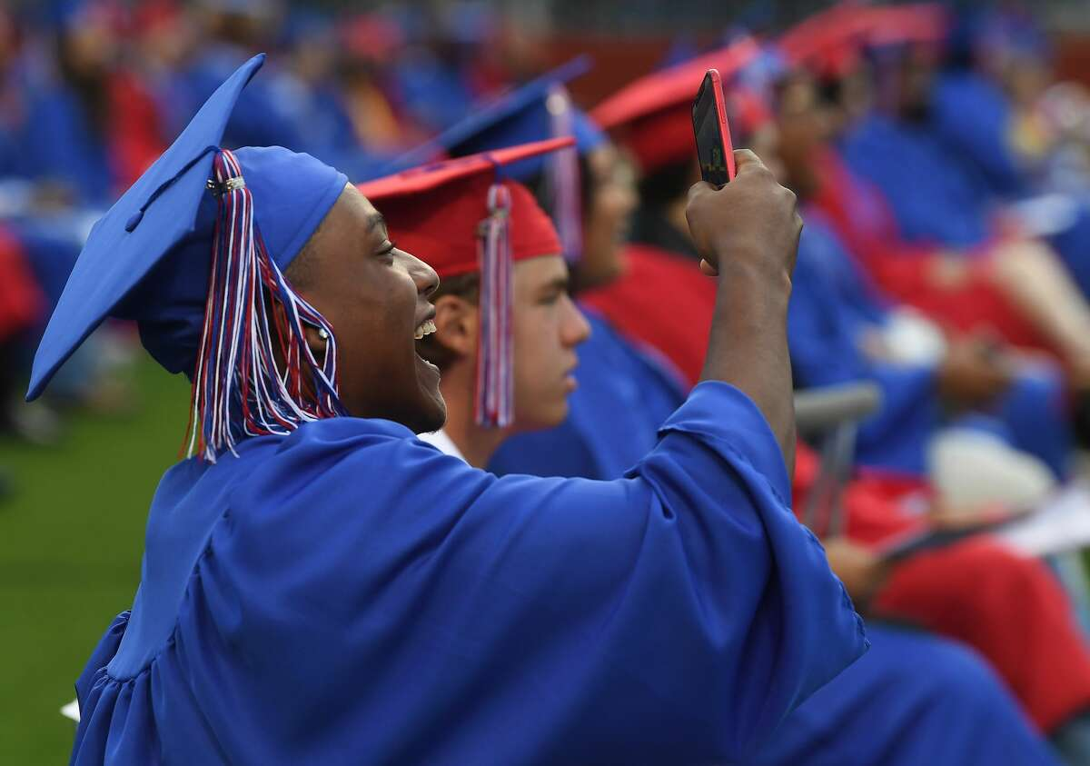 Graduates celebrate friends as the awarding of diplomas gets underway during West Brook High School's class of 2021 commencement at Memorial Stadium Wednesday. Photo made Wednesday, June 2, 2021 Kim Brent/The Enterprise