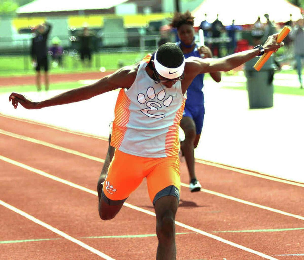 Edwardsville's Brandon Battle, shown finishing first in the 4x100 relay at the Belleville West Invite on May 1, won the 100, 200 and 400 along with the anchor of the winning 4x1 to lead the Tigers to the title of the SWC Meet on Wednesday at East St. Louis.