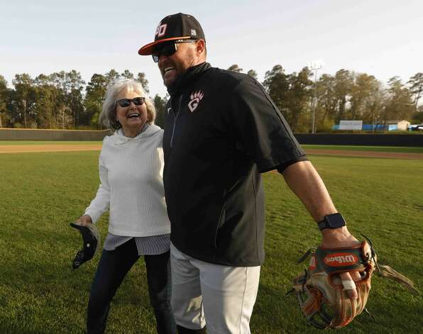 Annette Ferrell shares a moment with her son, Lou, after throwing out the first pitch before a District 13-6A high school baseball game at Conroe High School, Wednesday, March 17, 2021, in Conroe. The Conroe Tigers honored Annette's huband and longtime coach Mike Ferrell before the game. Ferrell, who lead the Tigers for 33 years, died last August. Photo: Jason Fochtman/Staff Photographer