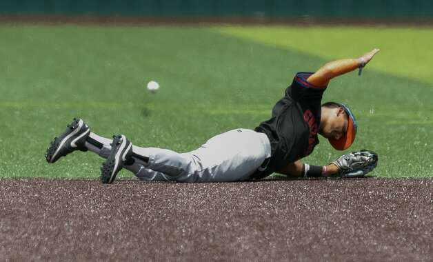 Grand Oaks shortstop Larry Drake (3) slams his fist on the ground after missing a single by Robert Oropeza #1 of Tomball Memorial during Game 3 of a Region II-6A area high school playoff game at Tomball Memorial High School, Saturday, May 15, 2021, in Tomball. Photo: Jason Fochtman/Staff Photographer / 2021 © Houston Chronicle