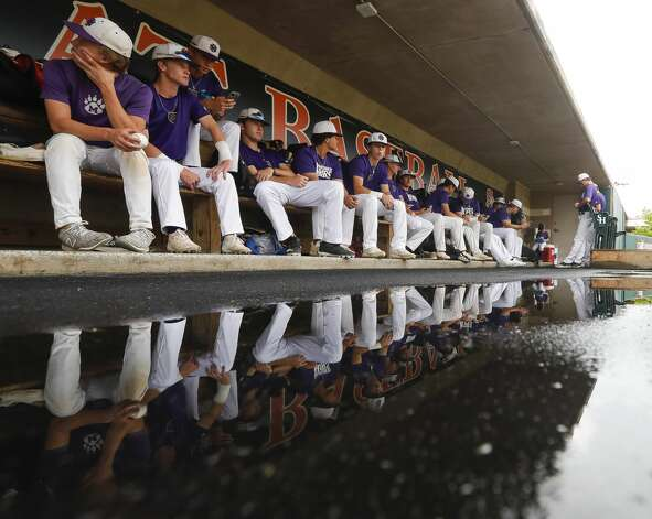 Montgomery players wait in the dugout during a weather delay prior to Game 2 of a high school baseball Region II-6A quarterfinal series at Sam Houston State University, Friday, May 21, 2021, in Huntsville. Photo: Jason Fochtman/Staff Photographer / 2021 © Houston Chronicle