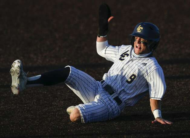 Jaron Lyness #9 of Lake Creek steals third base in the first inning of Game 1 of a Region III-5A high school baseball semifinal series at Humble High School, Wednesday, May 26, 2021, in Humble. Photo: Jason Fochtman/Staff Photographer / 2021 © Houston Chronicle