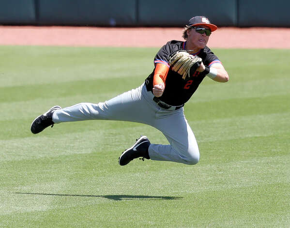 Grand Oaks center fielder Connor McBryde (2) makes a diving catch to get out Tyler Rollins #14 of Rockwall in the third inning of Game 2 during a Region III-5A semifinal series at Blue Bell Park, Saturday, May 29, 2021, in College Station. Photo: Jason Fochtman/Staff Photographer / 2021 © Houston Chronicle