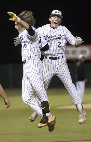 T.J. Peters #16 of Magnolia jumps in excitement with teammate Jordan Miller #2 after Peters hits a homerun during the seventh inning in Game 1 of the Region III-5A bi-district baseball series against Montgomery at Magnolia High School, Thursday, May 6, 2021, in Magnolia. Photo: Gustavo Huerta/Staff Photographer / Houston Chronicle © 2021
