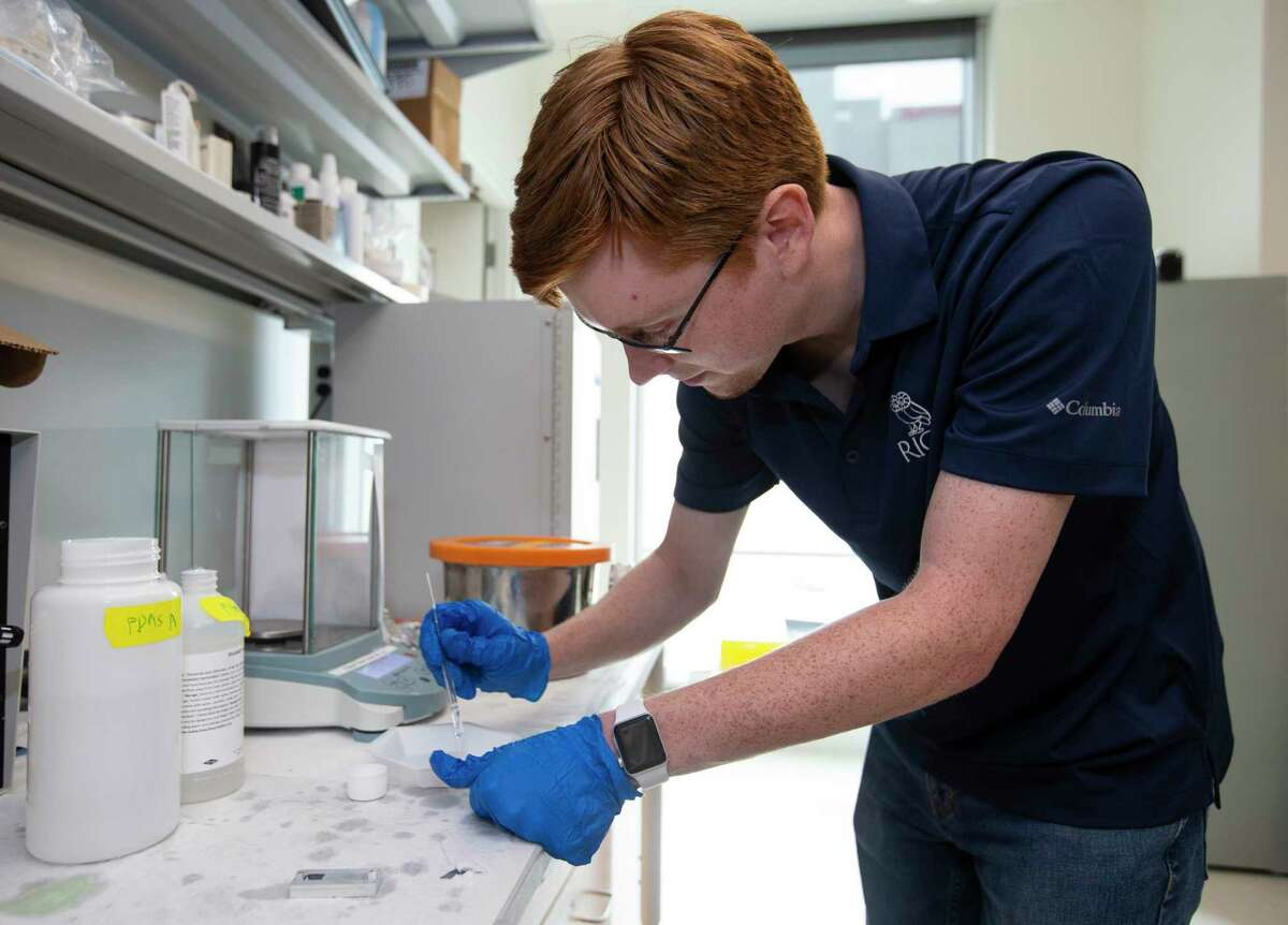 Rice University electrical and computer engineering graduate student Matthew Parker mixes chemicals together to make a polymer that holds a circuit Friday, May 21, 2021, in Houston.