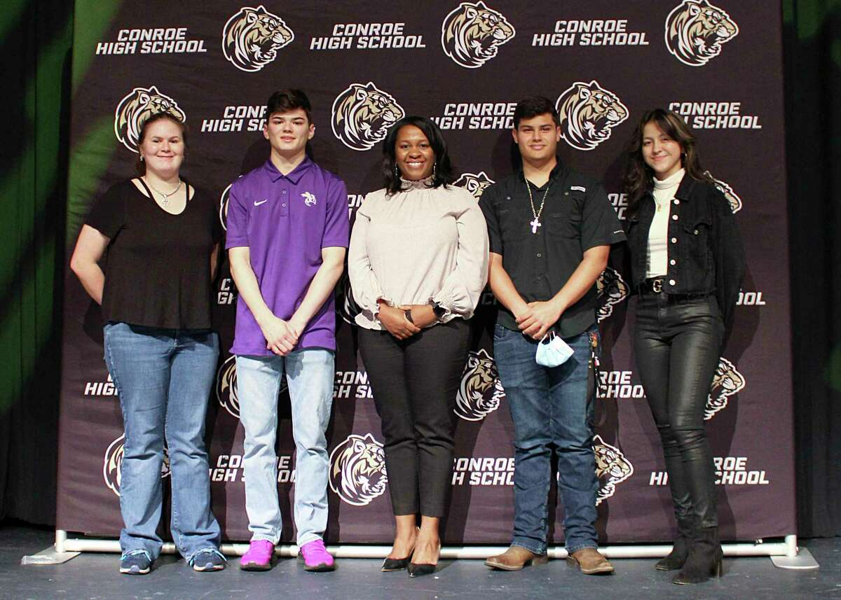 This year, Conroe High School chose to recognize students going into fine arts programs, and students who are career ready, with a signing day event. Pictured, CTE students graduating career ready pose with CHS Principal Rotasha Smith. From left to right: Jordan Meyers, Bryson Cole, Principal Rotasha Smith, Henry Hernandez, and Yaneli Bonilla.