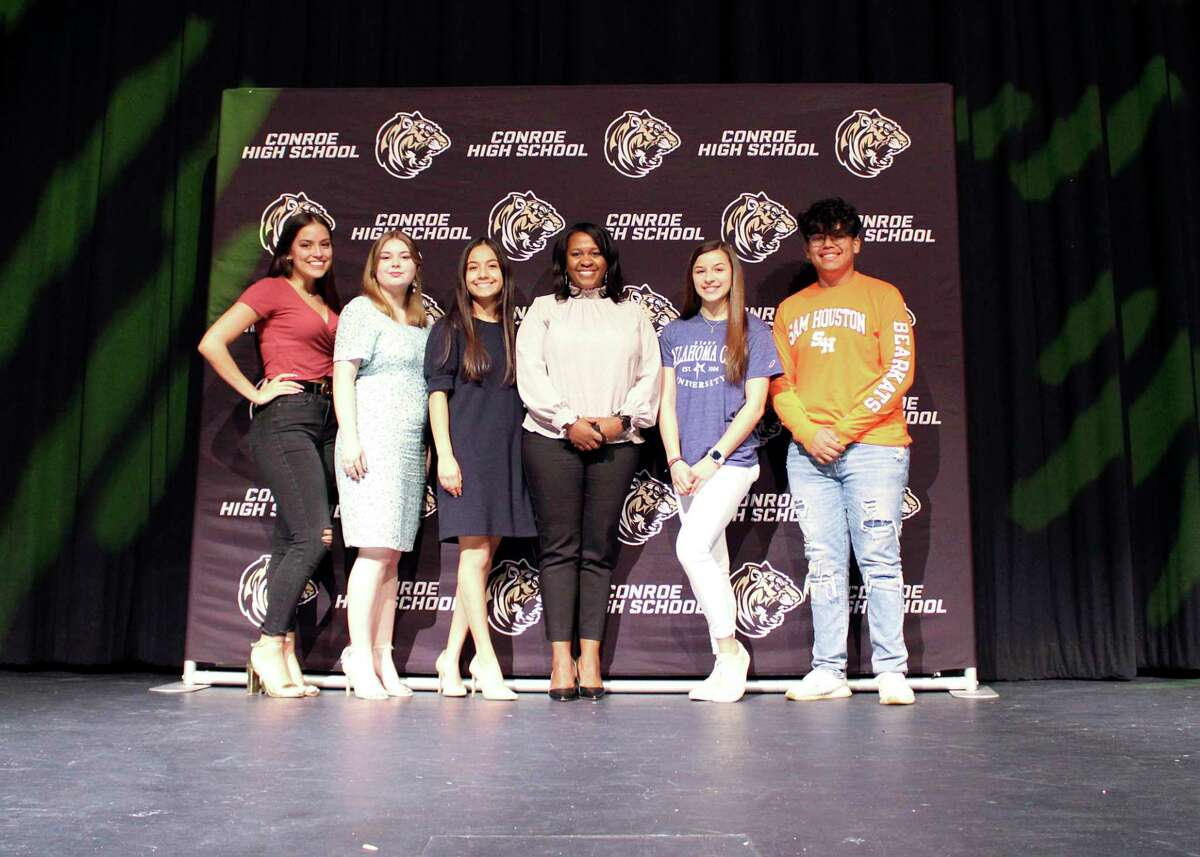 This year, Conroe High School chose to recognize students going into fine arts programs, and students who are career ready, with a signing day event. Pictured, students entering a fine arts program next year pose with CHS Principal Rotasha Smith. From left to right: Hailey Britton, Maddison Fleetwood, Anissa Castillo, Principal Rotasha Smith, Abigail Hinojosa, and Rafael Avalos.