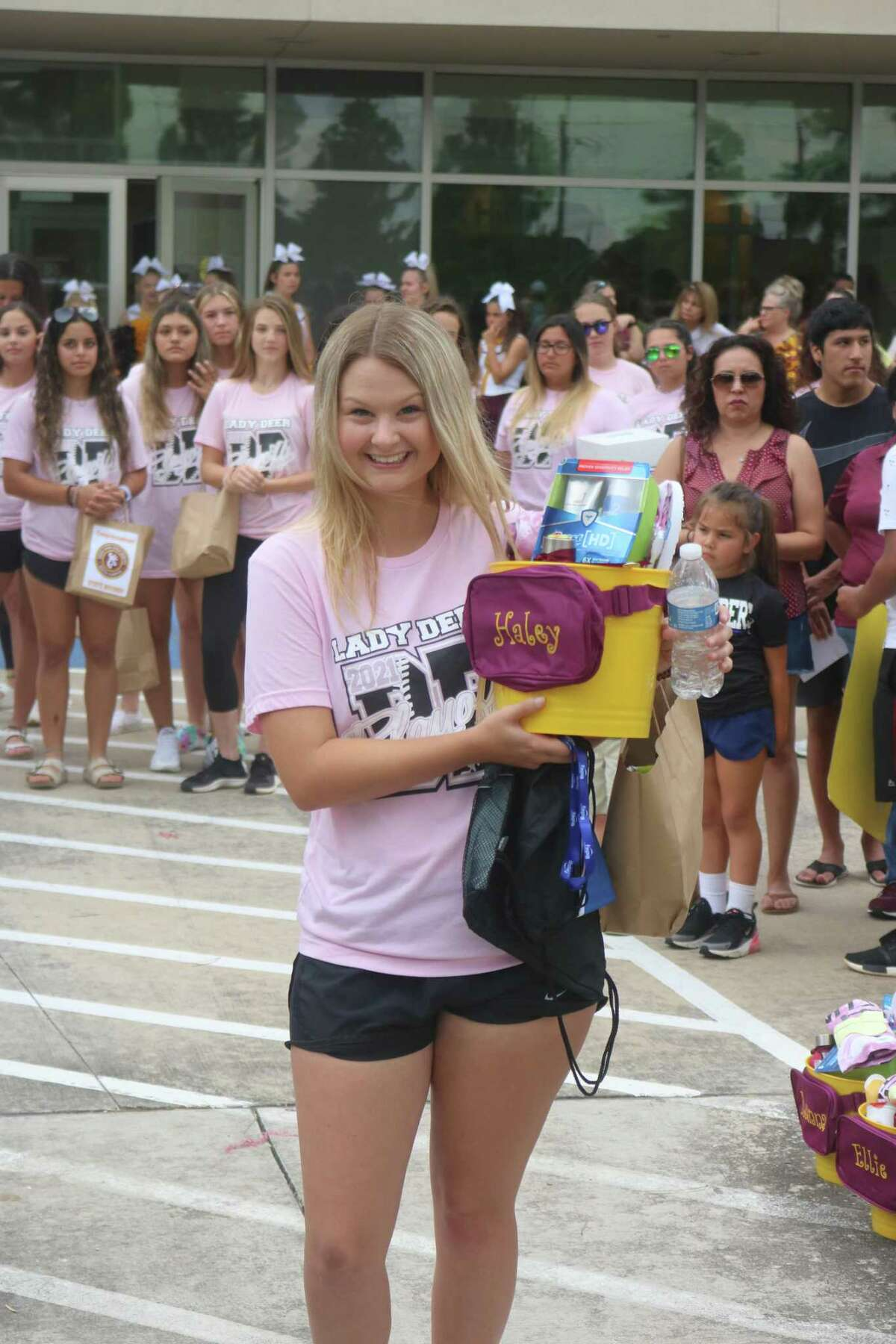 Infielder Haley Wilkerson picks up her bucket of goodies before boarding the bus and the team's trip to Austin for the Class 6A state championship.