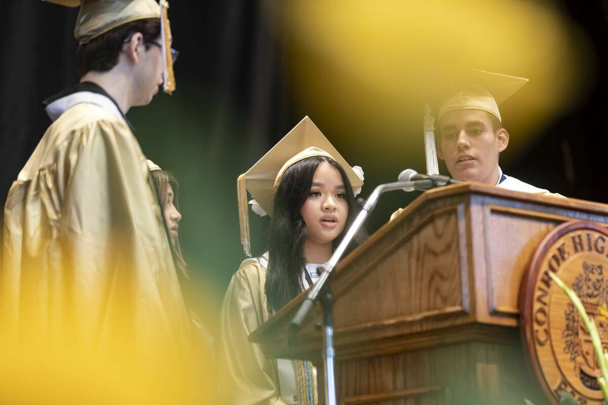 Leonela Reyes Hernandez, center, sings the national anthem during Conroe High School's graduation ceremony at the Cynthia Woods Mitchell Pavilion, Friday, May 21, 2021, in The Woodlands.