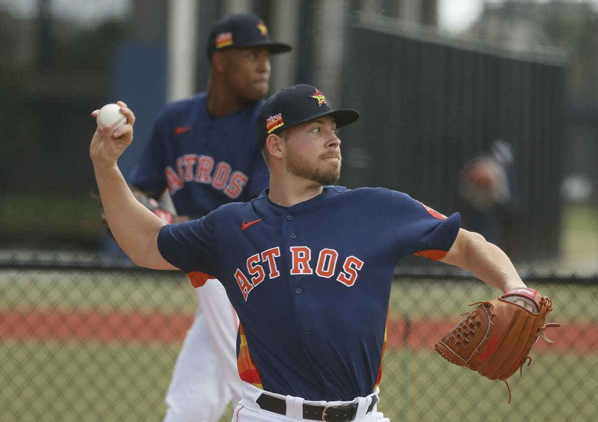 Houston Astros pitcher Brett Conine (73) pitches during the first full squad workouts for the Astros, in West Palm Beach, Florida, Monday, February 22, 2021.