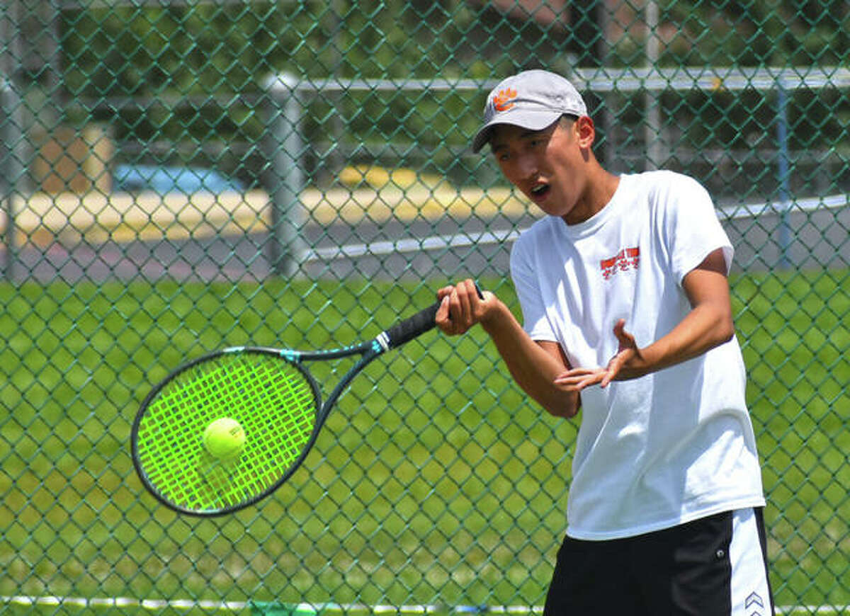 Edwardsville's Adrian Norcio hits a return shot in his No. 5 singles championship match at the Southwestern Conference Tournament on Monday in O'Fallon.