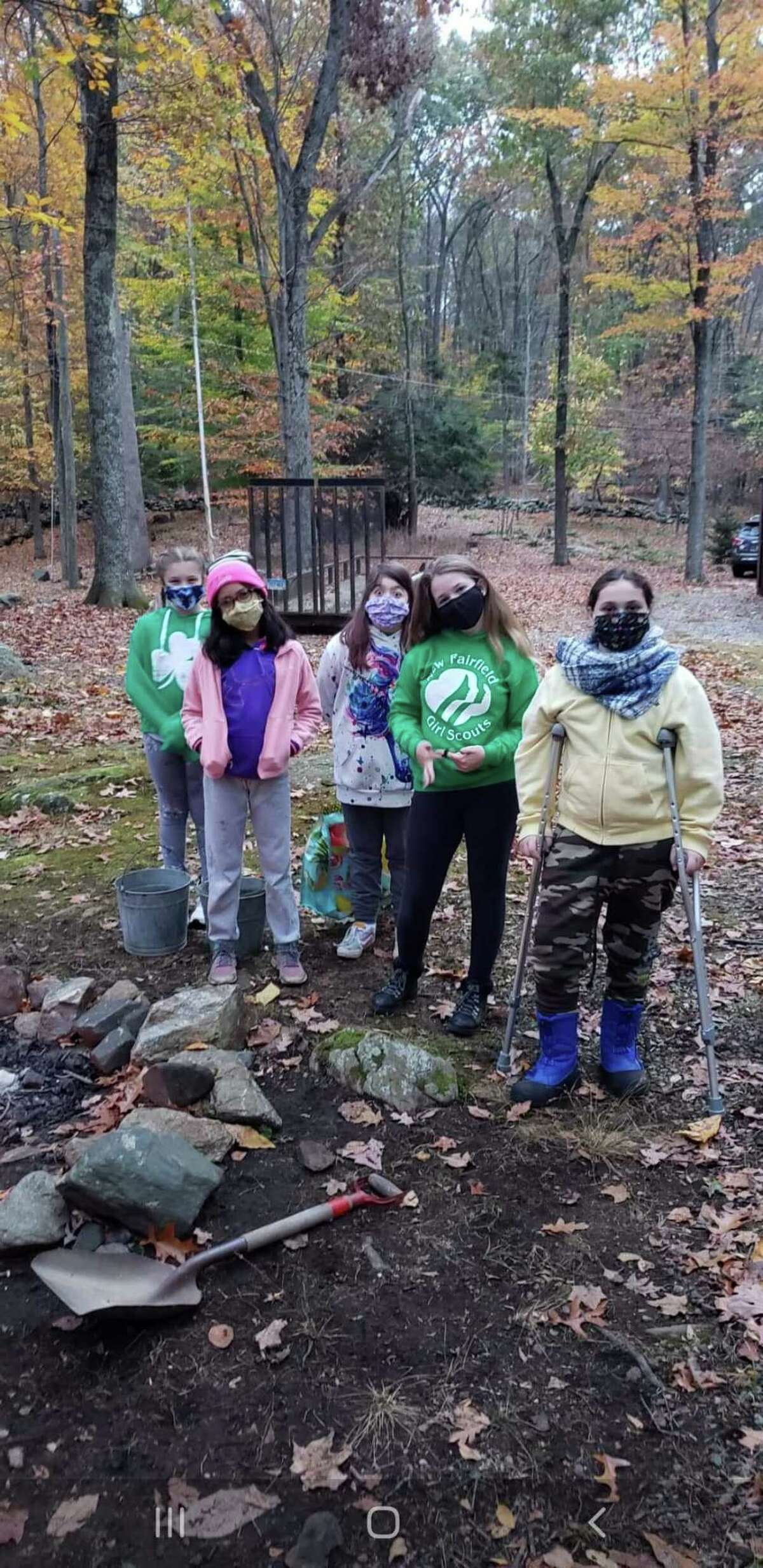 Troop leader Lori Pires Magnante said she's heartbroken that the Girl Scouts of Connecticut are selling Camp Candlewood as her scouts enjoy attending Camporee there.