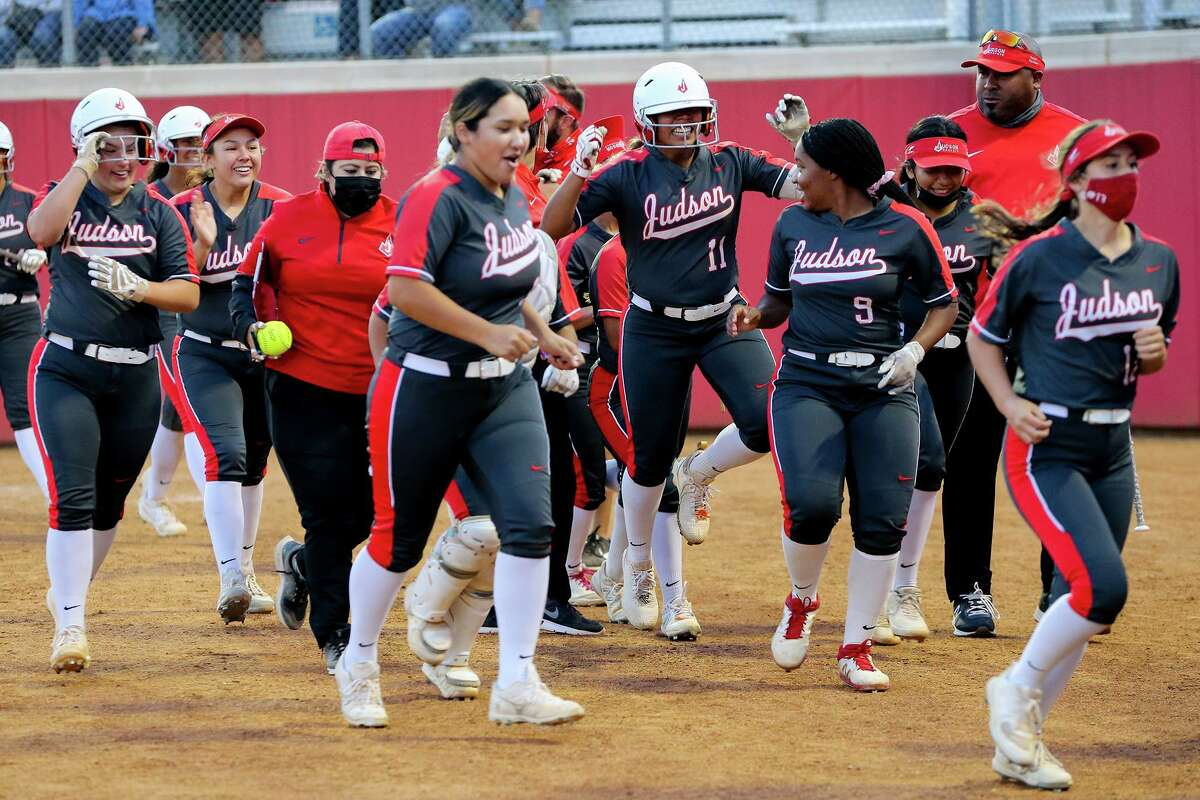 Judson's Destiny Rodriguez, 11, and the Lady Rockets celebrate Rodriguez's three run home run in the seventh inning of their one-game Class 6A softball playoff game with Round Rock at Buda Hays High School in Buda on Thursday, May 12, 2021. Judson scored five runs in the top of the seventh inning to beat Round Rock 7-4.