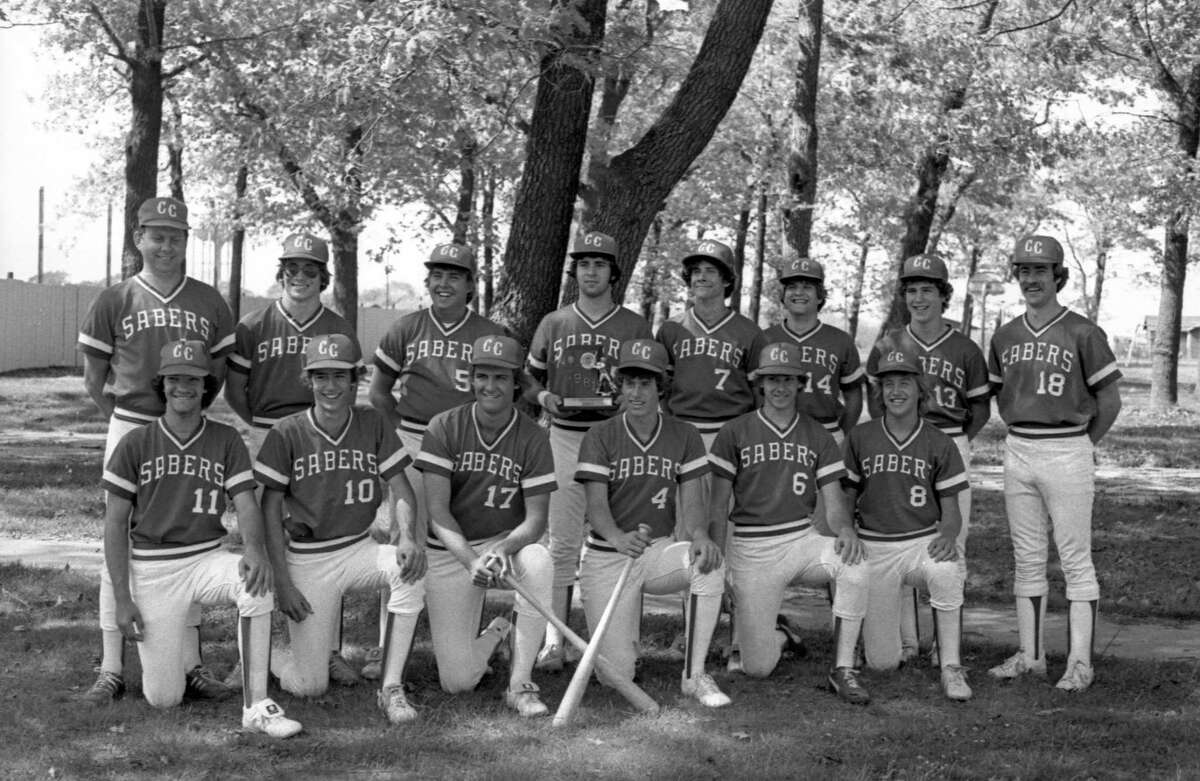 The Manistee Catholic Central baseball team, which won the Class D district championship last week, is ready and eager for the Class D regional in Allendale. (From left, front row) Ken Baranek, Tom Zatarga, Steve Anderson, Scott Markham, Dave Cabot and Phil Fortier. (From left, back row) Coach Ron Hoffman, Jon Hansen, Jim Kaminski, Al Duchon, Marty Baranek, Bob Osborn, Scott Maternowski and assistant coach Steve Duchon. The photo was published in the News Advocate on June 5, 1981. The Sabers lost to Mesick 11-4. (Manistee County Historical Museum photo)