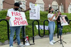 Jazmarie Melendez, whose brother Jayson Negron was killed in an officer-involved shooting in Bridgeport in 2017, speaks to a crowd of protesters at Hamden police headquarters on June 2, 2021. The officer  involved, James Boulay, had applied for a job with the Hamden Police Department.