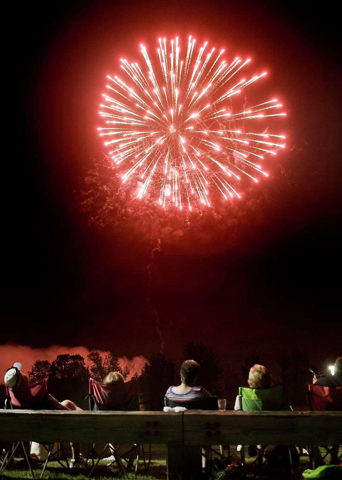 Spectators enjoy the Fourth of July fireworks at Ridgefield High School on Wednesday, July 4, 2018.