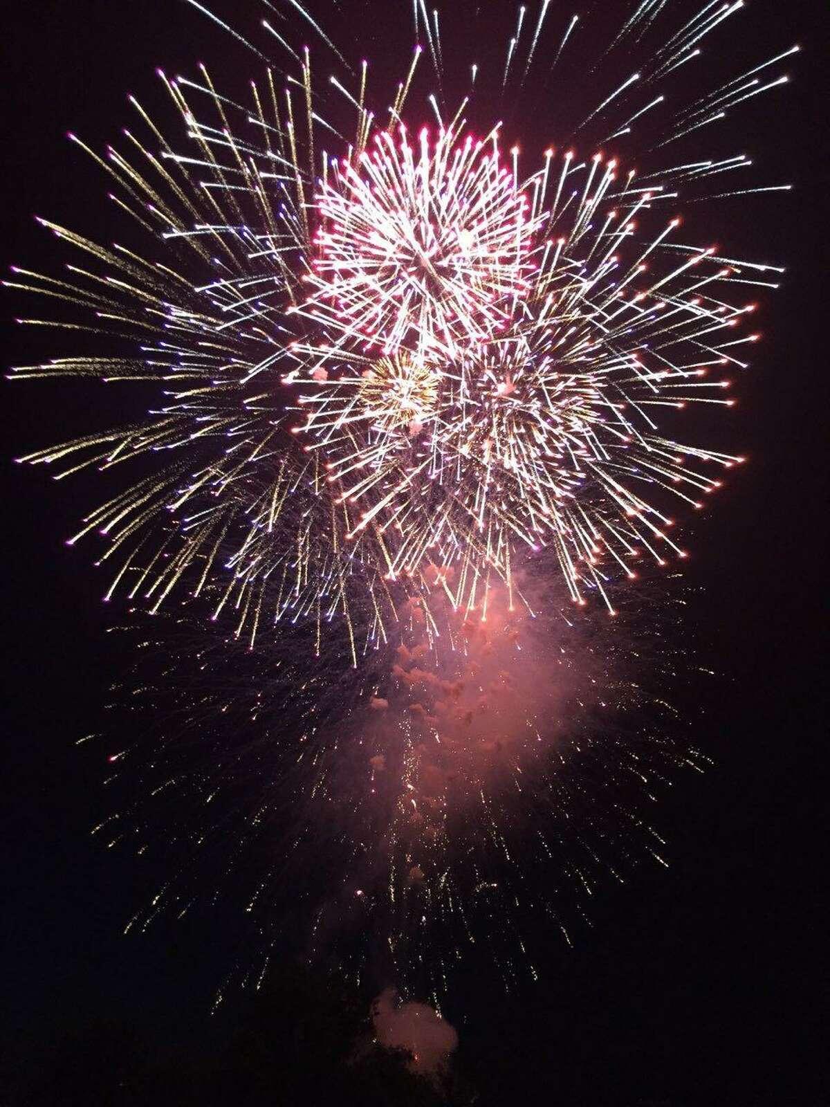 Spectators enjoy the Fourth of July fireworks at Ridgefield High.