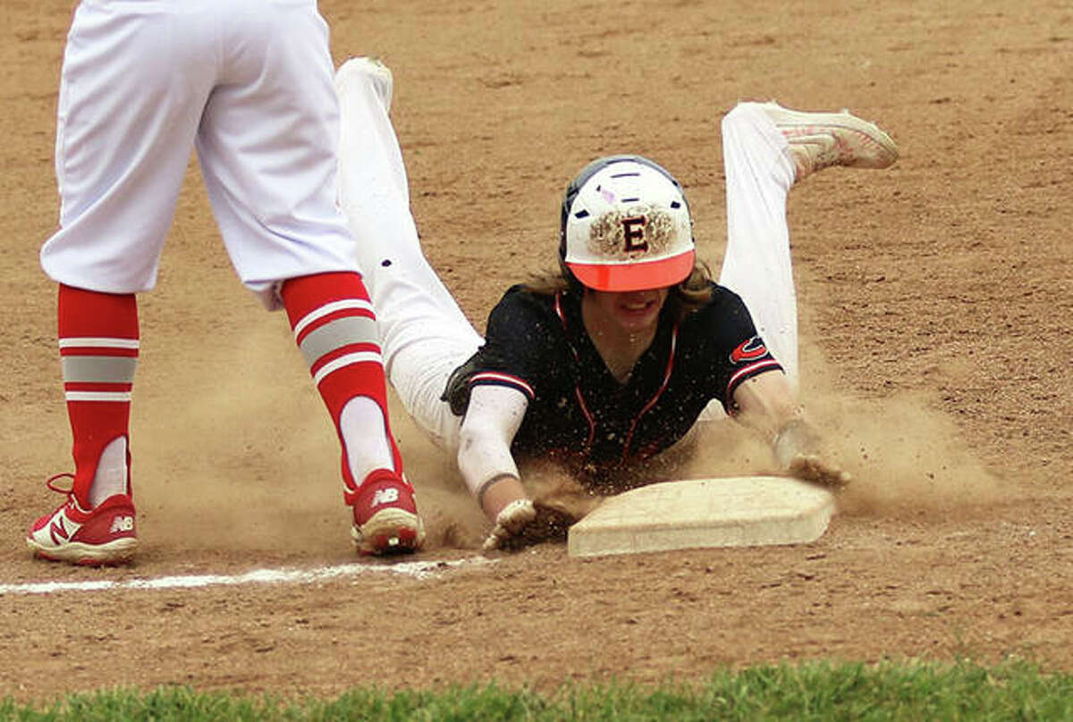 Edwardsville's Grant Huebner slides in with a triple against Alton in a May 15 game in Godfrey. On Wednesday in Highland, Huebner had a double and triple in a Tigers win at Highland that extended their winning streak to 26 in a row.