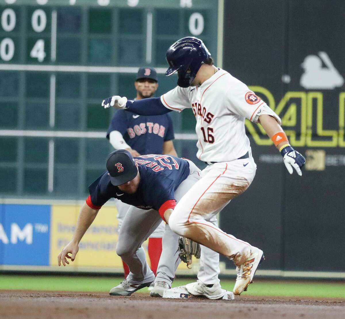 Houston Astros Aledmys Diaz (16) slides into second base against Boston Red Sox second baseman Christian Arroyo (39) after he doubled off of Boston Red Sox starting pitcher Martin Perez during the first inning of an MLB baseball game at Minute Maid Park, Thursday, June 3, 2021, in Houston.