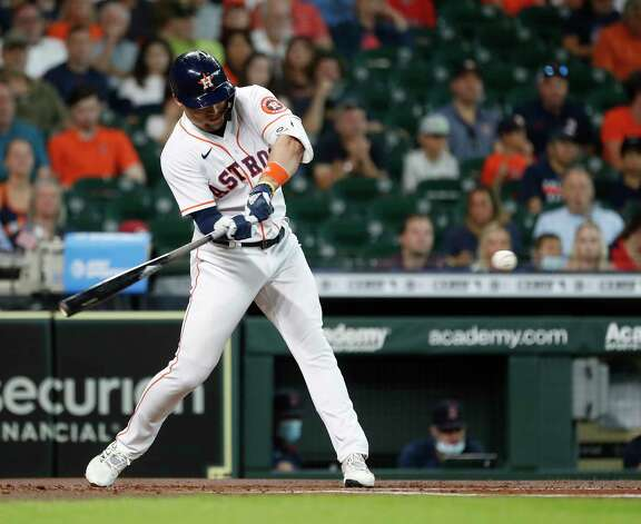 Houston Astros Aledmys Diaz (16) hits a double off of Boston Red Sox starting pitcher Martin Perez during the first inning of an MLB baseball game at Minute Maid Park, Thursday, June 3, 2021, in Houston. Photo: Karen Warren, Staff Photographer / @2021 Houston Chronicle