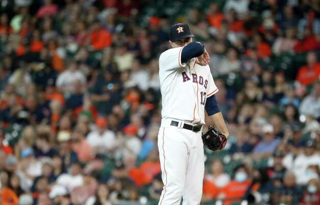 Houston Astros starting pitcher Jake Odorizzi (17) between pitches during the first inning of an MLB baseball game at Minute Maid Park, Thursday, June 3, 2021, in Houston. Photo: Karen Warren, Staff Photographer / @2021 Houston Chronicle
