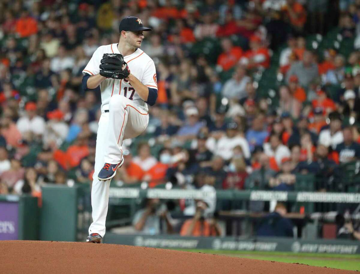 Houston Astros starting pitcher Jake Odorizzi (17) pitches during the first inning of an MLB baseball game at Minute Maid Park, Thursday, June 3, 2021, in Houston.