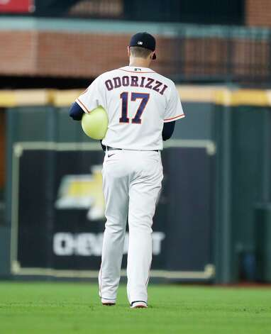 Houston Astros starting pitcher Jake Odorizzi (17) walks out to the bullpen to warm up with a large ball before the start of the first inning of an MLB baseball game at Minute Maid Park, Thursday, June 3, 2021, in Houston. Photo: Karen Warren, Staff Photographer / @2021 Houston Chronicle