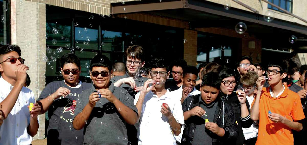Students blow bubbles during CAST Tech High School's grand opening in 2017. Now the first group of graduates is set to cross the stage. Onward!
