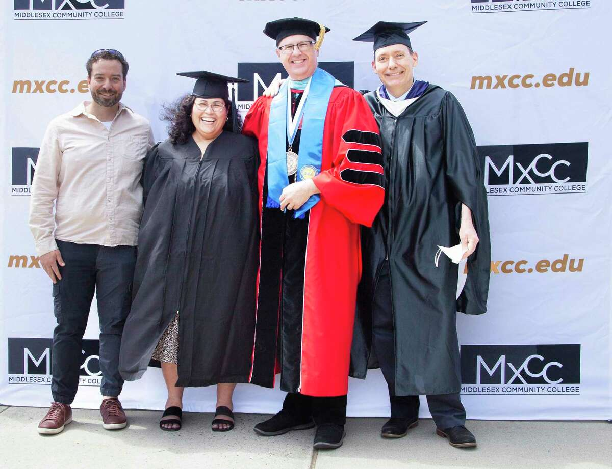 Middlesex Community College's graduation ceremony was held May 28 in Middletown. From left are Daniel McGloin of the Wesleyan University Center for Prison Education program, Marisol Garcia, CEO Steven Minkler and Professor Tad Lincoln.