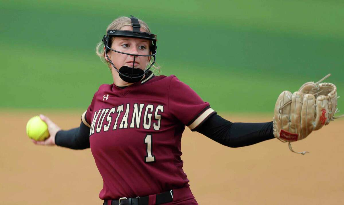 Magnolia West starting pitcher Toni Tamborello (1) throws during the first inning in Game 2 of a Region III-5A bi-district softball series at Grand Oaks High School, Friday, April 30, 2021, in Spring.