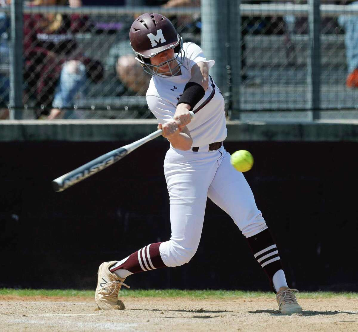 Jade Bubke #16 of Magnolia hits a single in the second inning of a District 19-5A high school softball game at Magnolia High School, Saturday, March 20, 2021, in Magnolia.