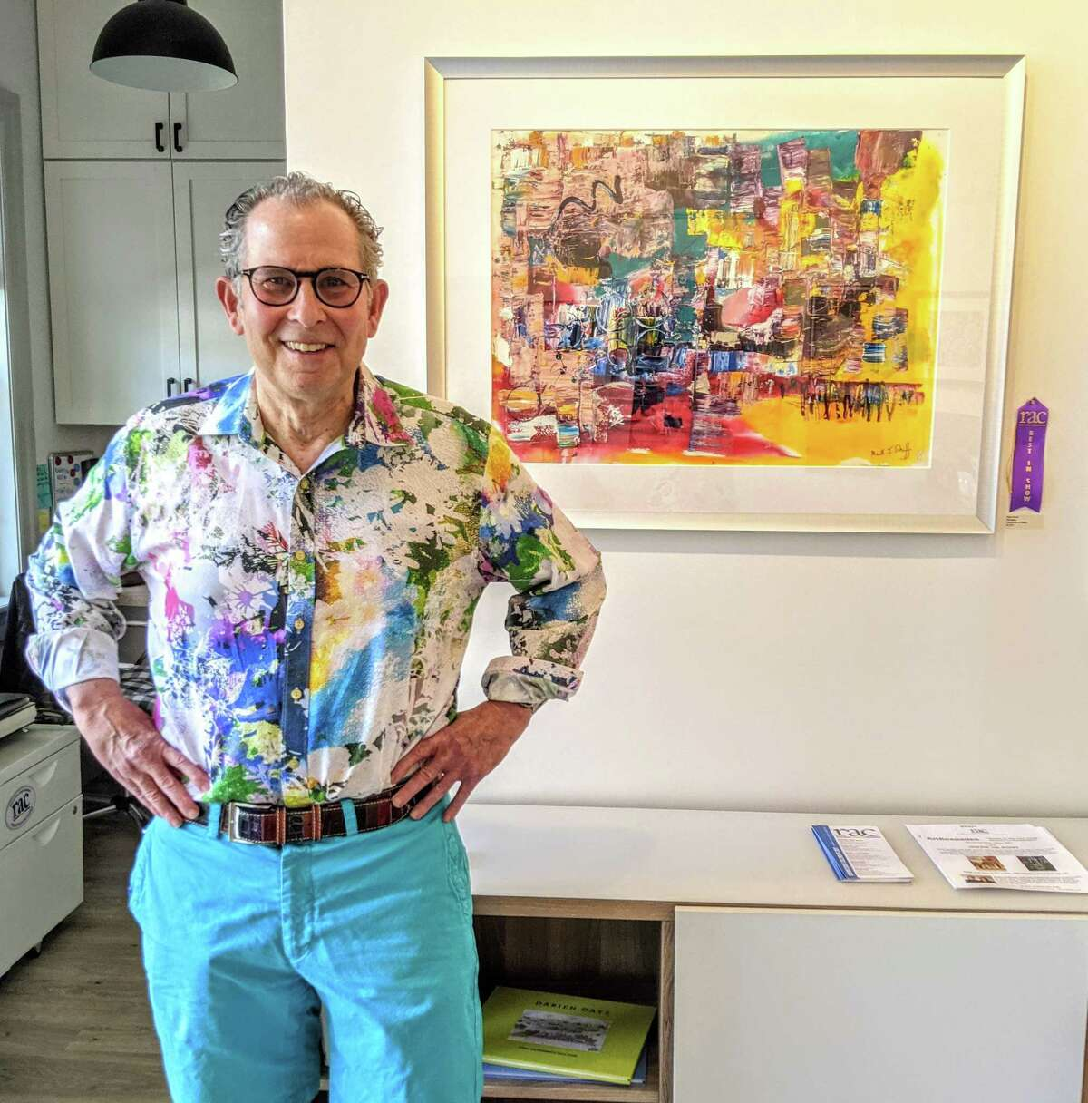"""Mark Schiff poses with his painting """"Shanghai,"""" which won Best in Show at the Rowayton Arts Center's juried show """"In the City."""" The show is on display through June 20."""