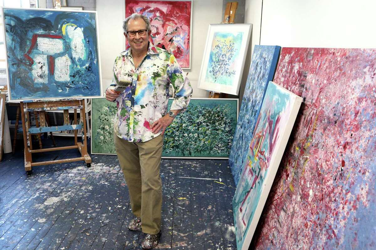 """Artist Mark Schiff poses in his Norwalk studio. He recently won first place at the Rowayton Arts Center's juried show """"In the City."""""""