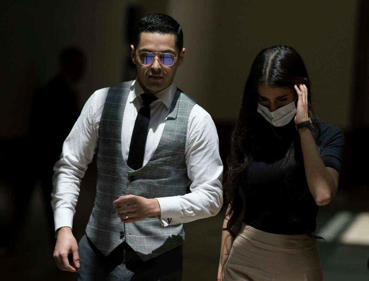 Victor Hugo Cuevas, a 26-year-old linked to a missing tiger named India, and his wife exit Fort Bend County Justice Center during a lunch break in the bond revocation hearing of a separate murder charge he's facing on Friday, May 14, 2021, in Richmond.